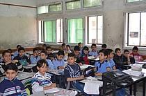 """צפיפות־יתר בכיתה בבית הספר היסודי לבנים ספד """"ב"""" במזרח עזה / © צילום: אונסק""""ו / בילאל אל־חמיידה"""