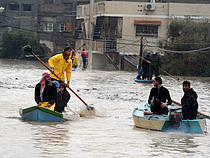 Civil Defense staff evacuating people from Al Nafaq area in Gaza City, 2013. Photo by Shareef Sarhan\UNRWA
