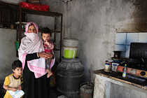 Mona and two of her seven children, in a poor household affected by electricity and water shortages. Rafah, Gaza Strip, October 2017. © Photo by OXFAM