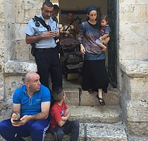 Settler family leaving Palestinian evicted property in East Jerualsem, shortly after taking it over on 15 September 2016. Photo by OCHA