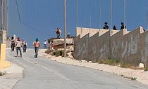 Israeli settlers, accompanied by Israeli soldiers, assault 'Urif village (Nablus), 6 July 2018. © Photo by 'Adel al-'Amer/B'Teselem
