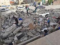 Demolition of a three-storey building in Al 'Isawiya community (East Jerusalem) on 1 May. Photo by OCHA.
