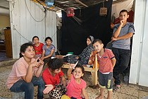 Khader's family, in their caravan which they have lived in since October 2014, Beit Hanoun, August 2017. © Photo by OCHA