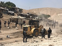 Israeli forces leveling land next to Khan Al Ahmar, in preparation for the demolition of the community, 4 July 2018. © Photo by JFF