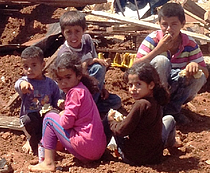 Palestinian refugee children from East Tayba Bedouin community, following the demolition of their home, 20 August 2014. Photo by OCHA