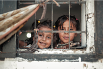 Rimas, 7, and her sister, Layan, 11, at risk of eviction from their rented home in Jabalia (Gaza),  August 2019. ©  Photo by Ahmed Mashharawi, NRC