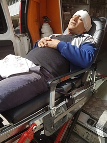 Naji Tanatra at the ambulance that evacuated him to the hospital.