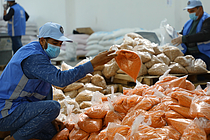 UNRWA staff packing food for Palestine refugees in the Gaza Strip. Photo by UNRWA.