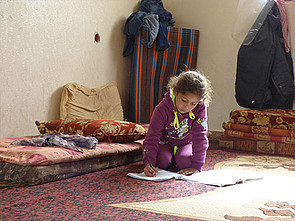 Displaced Palestinian girl in temporary accommodation in Gaza. © Photo by OCHA, February 2015.