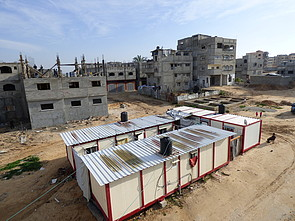 Caravans provided to displaced families and buildings under reconstruction in Shuja'iyeh neighbourhood, Gaza city, January 2016. © Photo by OCHA