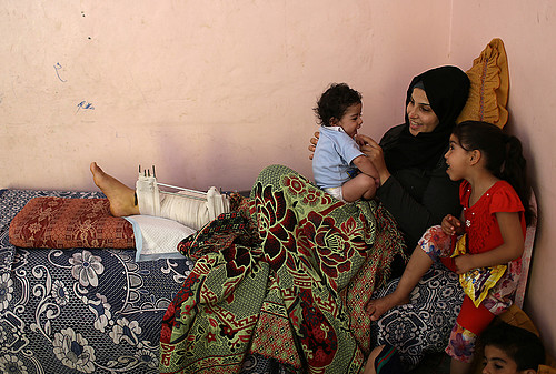 A women injured in a demonstration at the fence in Gaza. © Photo by Women Affairs Centre.
