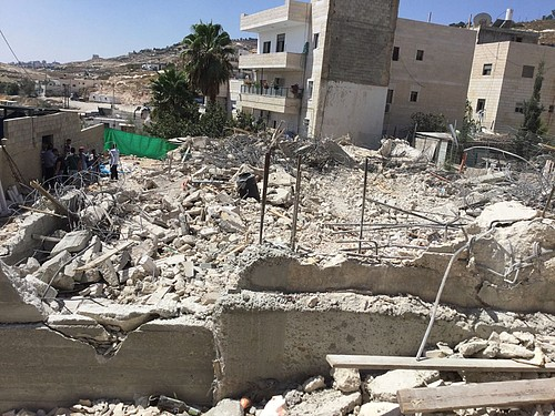 Demolition of a residential building under construction in Al 'Isawiya in East Jerusalem on 15 August. Photo by OCHA.