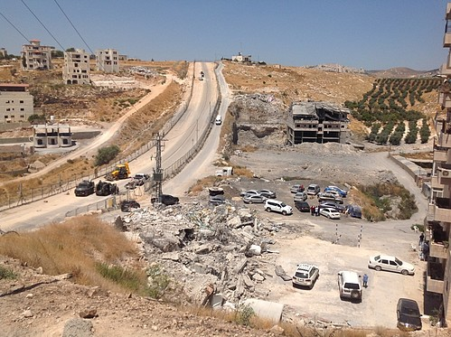 Buildings in Sur Bahir demolished on 22 July 2019 next to the security road along the Barrier. ©  Photo by OCHA