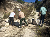 Farmers from Burqa as they remove stones which settler used to block the road to their land, Burqa, October 2017. © Photo by OCHA